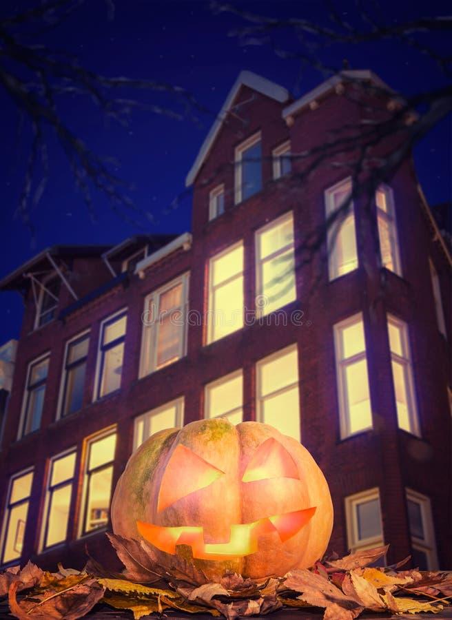 Pumpkin near the house. Scary pumpkin near the house at night stock photography