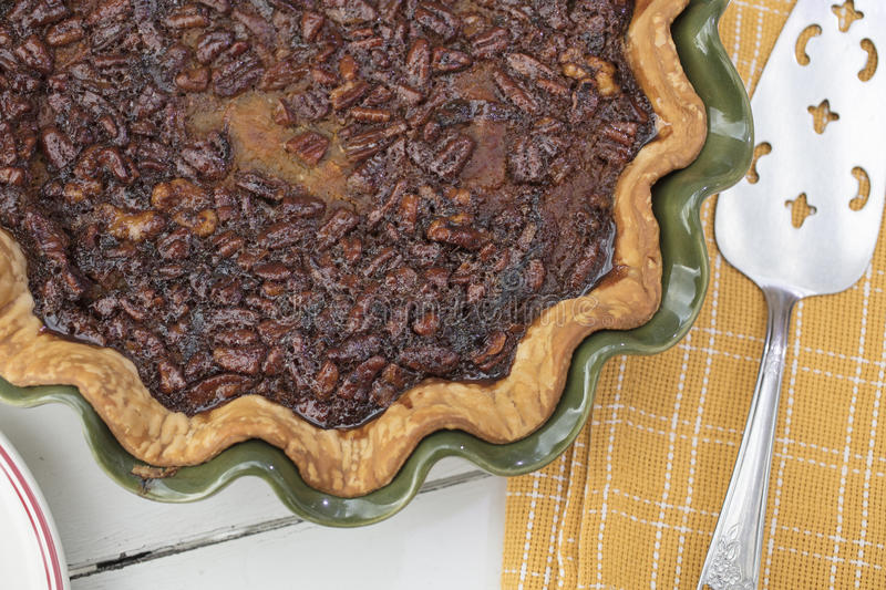 Pumpkin Pecan Walnut Pie Baked in a Green Ceramic Dish royalty free stock images