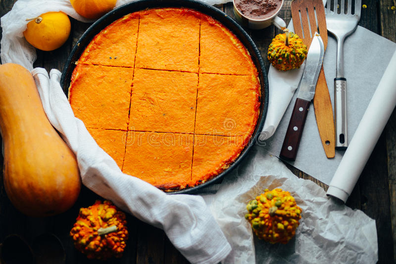 Pumpkin pie with autumn decorations on vintage wooden table. Pu royalty free stock photo