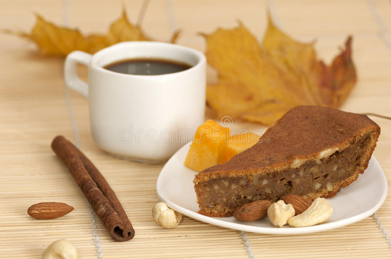 Pumpkin pie with a cup of coffee royalty free stock photos