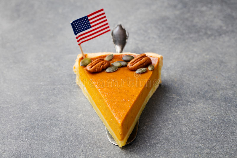 Pumpkin pie, tart with American flag on top stock photography