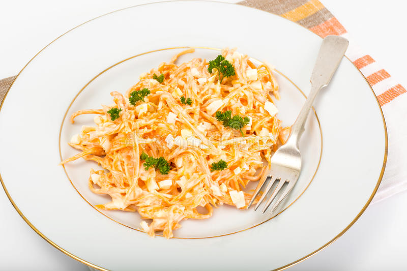 Pumpkin salad with egg, garlic and mayonnaise on a white plate. Studio Photo royalty free stock photography