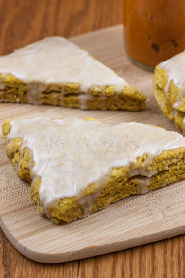 Pumpkin Scones. Fresh pumpkin scones with a sweet and spiced glaze on top stock images