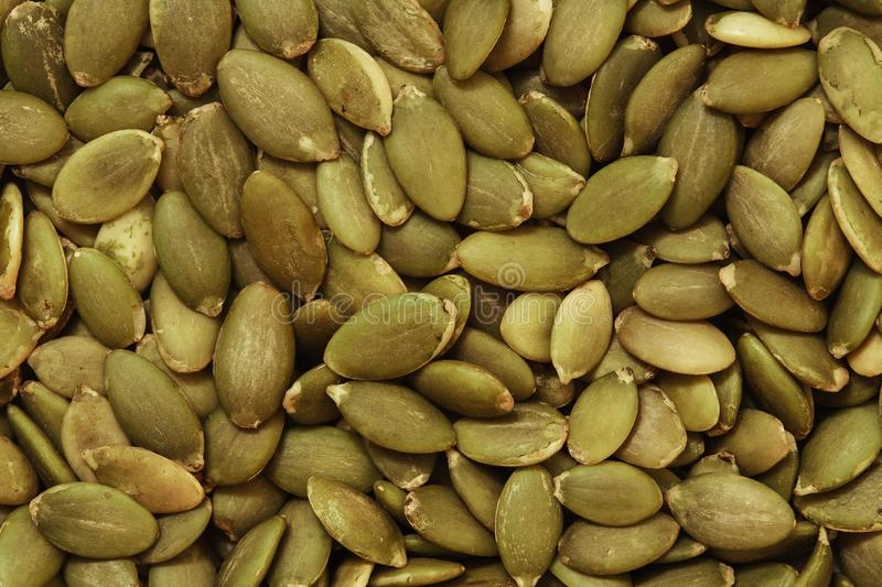 Pumpkin seed background. Pumpkin seeds texture, food photo background top view royalty free stock photography