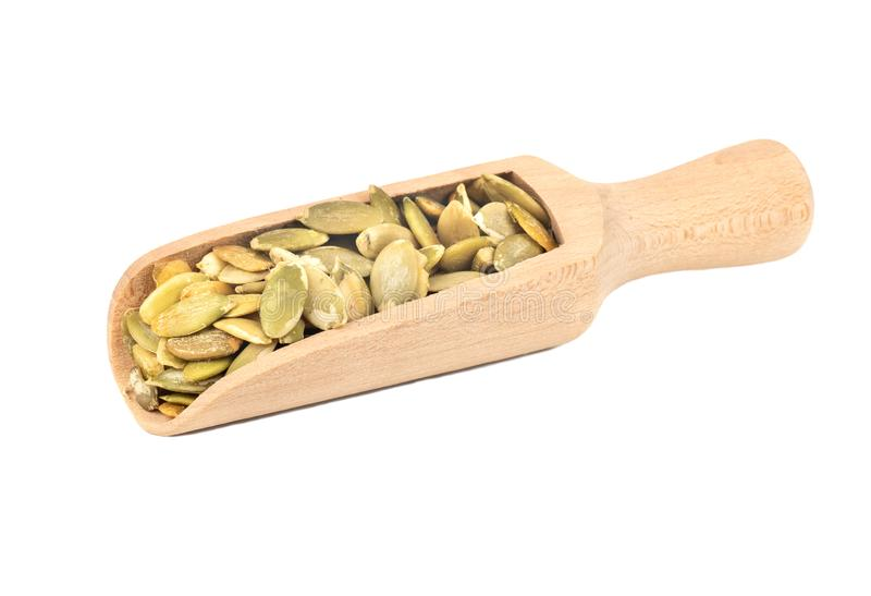 Pumpkin seed kernels in scoop stock image