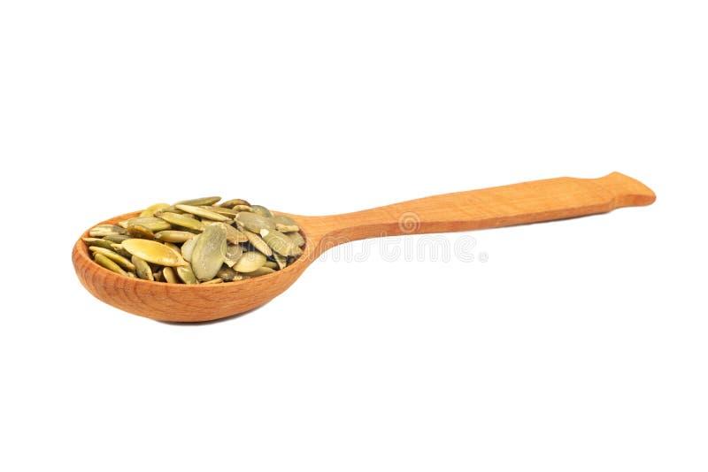 Pumpkin seed kernels in spoon royalty free stock photo