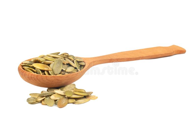 Pumpkin seed kernels in spoon royalty free stock photography