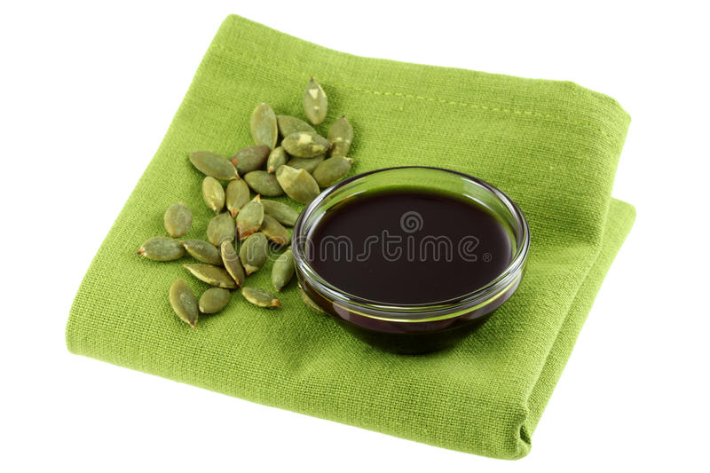 Pumpkin Seed Oil and some Roasted Pumpkin Seeds stock photos