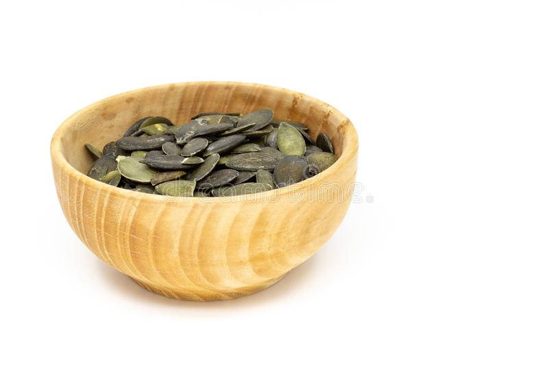 Pumpkin seed in wooden saucer stock images