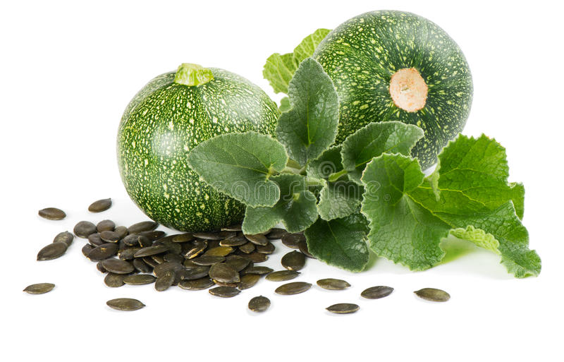 Pumpkin Seeds and plant. Pumpkin seeds and pumpkins with leaves on white background stock images