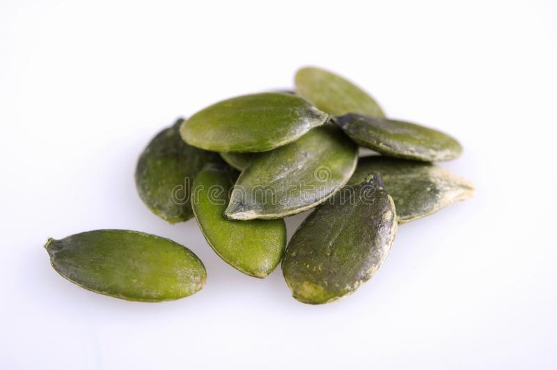 Pumpkin seeds. On a white background, , , seeds, coot, peeled pitted in a group, big and nice , in addition to cakes, salad ingredient stock photo