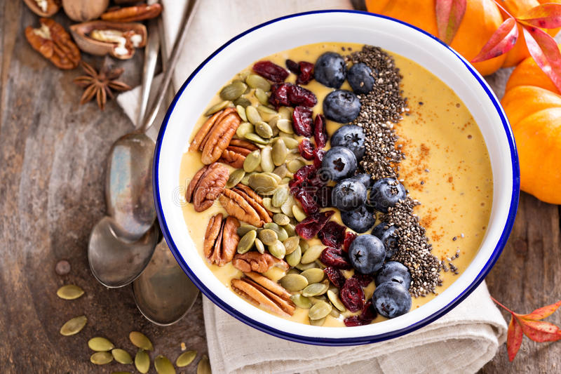 Pumpkin smoothie bowl with nuts and seeds royalty free stock image