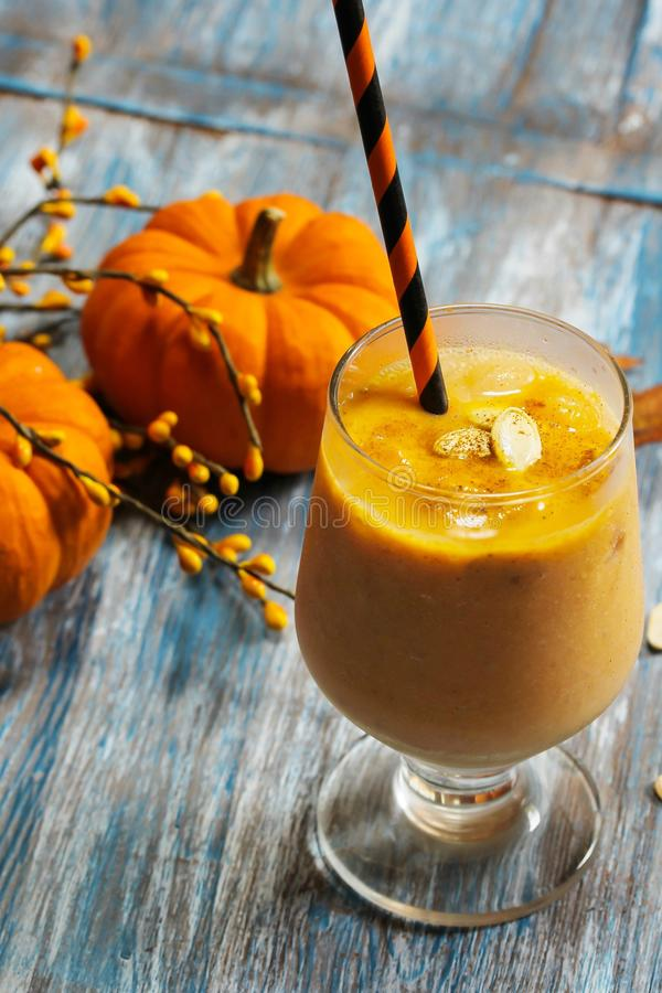 Pumpkin smoothie health drink with spices for winter. And thanksgiving halloween stock photography