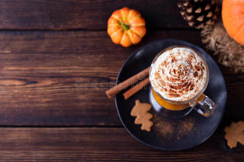 Pumpkin smoothie, spice latte. Boozy cocktail. With whipped cream on top on a wooden background. Copy space Top view stock photos