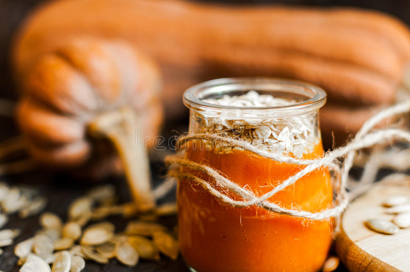 Pumpkin smoothies and seeds. Pumpkin puree smoothies and seeds royalty free stock photography
