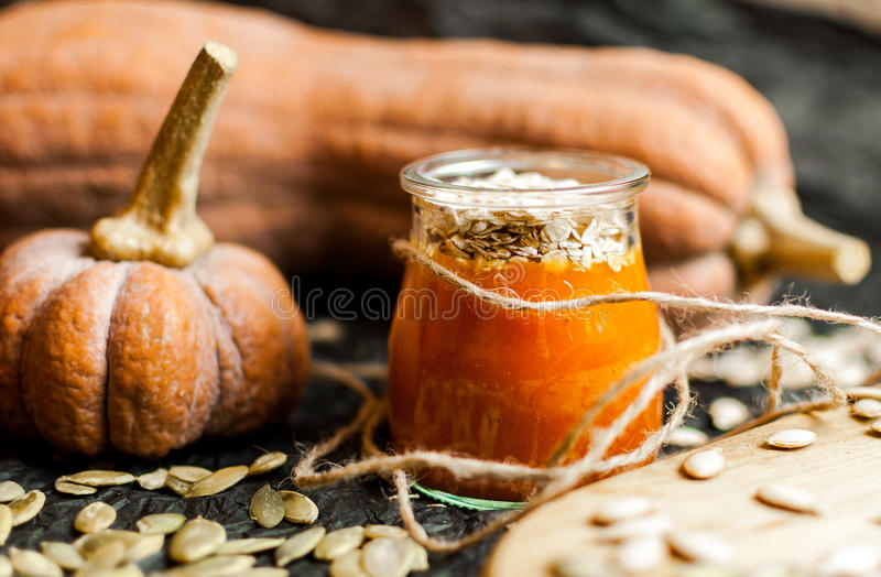 Pumpkin smoothies and seeds. Pumpkin puree smoothies and seeds stock image