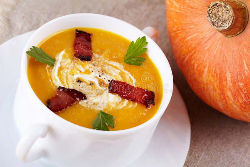Pumpkin soup. With smoked bacon royalty free stock photos
