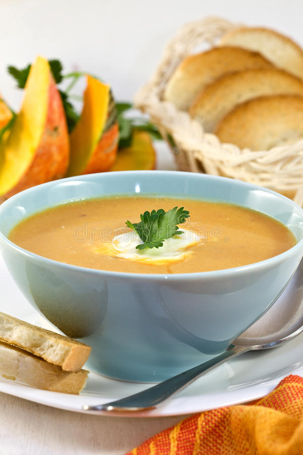 Download Pumpkin soup in a blue cup stock photo. Image of spoon - 27011414