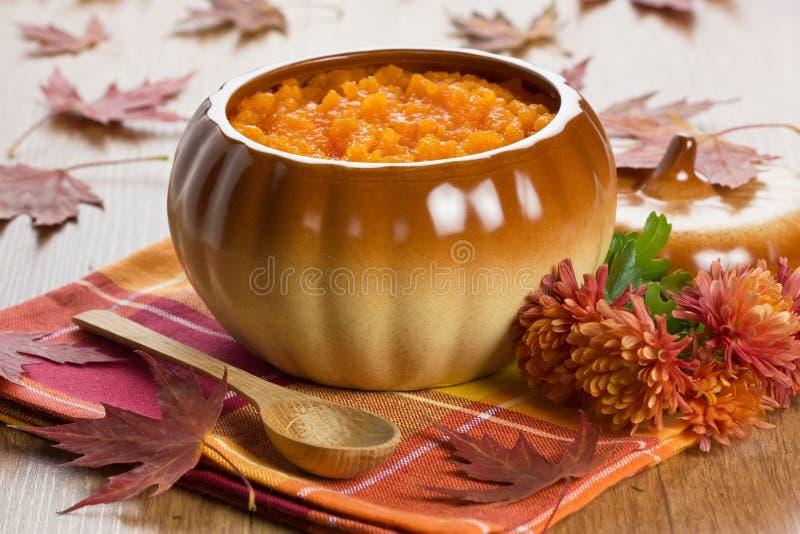 Pumpkin soup in ceramic pot stock photos