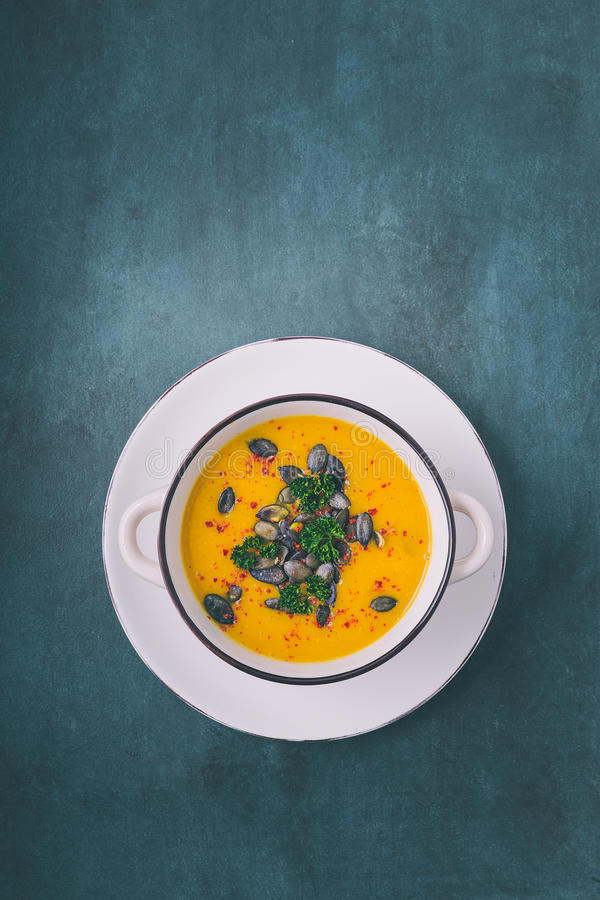 Pumpkin soup with pumpkin seeds and chili peppers stock photo