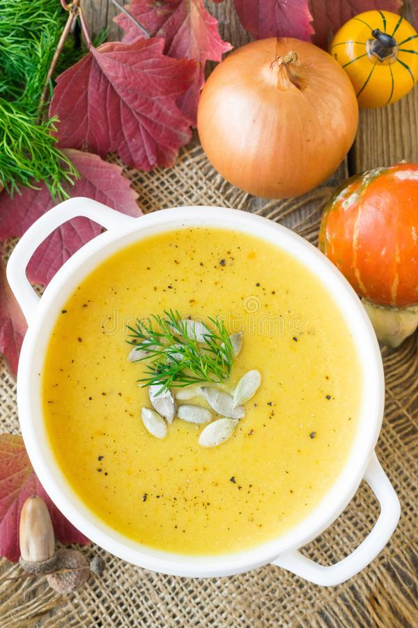 Pumpkin soup with vegetables served in a white ceramic plate stock photos