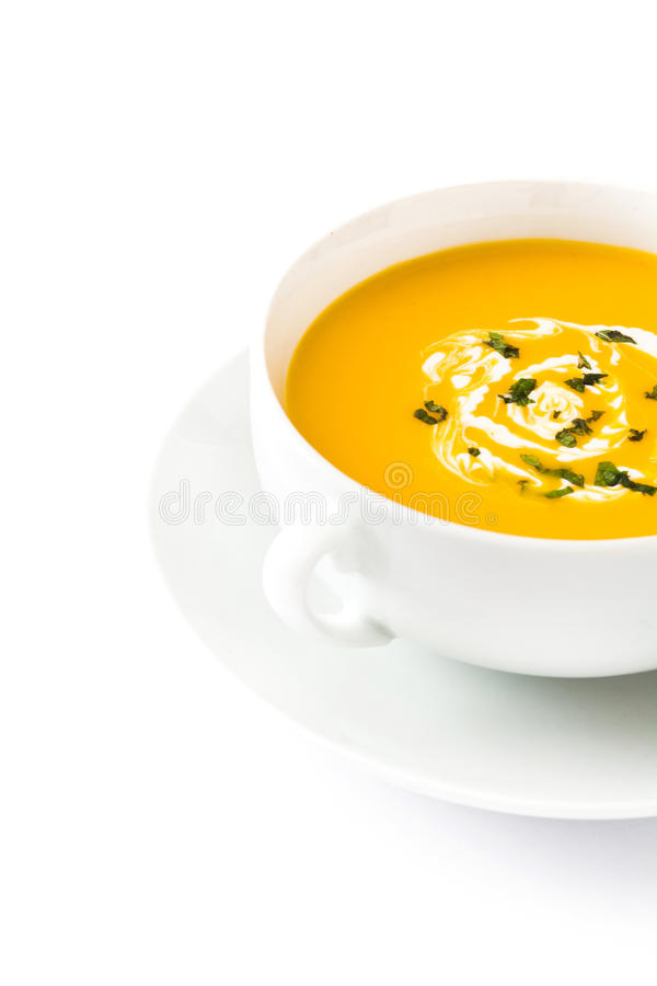 Pumpkin soup in white bowl isolated royalty free stock images