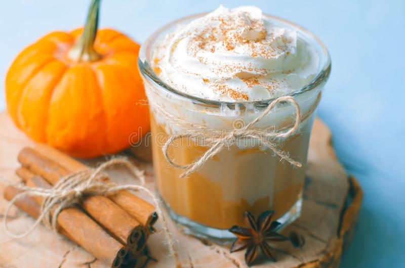 Pumpkin Spice Latte, Coffee, Milkshake or Smoothie with Whipped Cream and Cinnamon royalty free stock photography