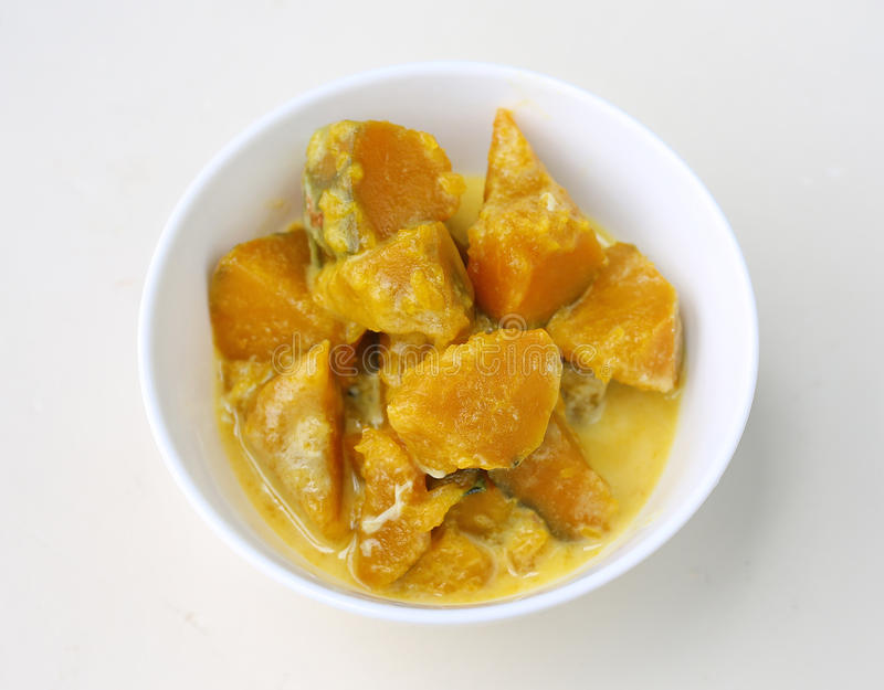 Pumpkin in syrup in white cup stock images