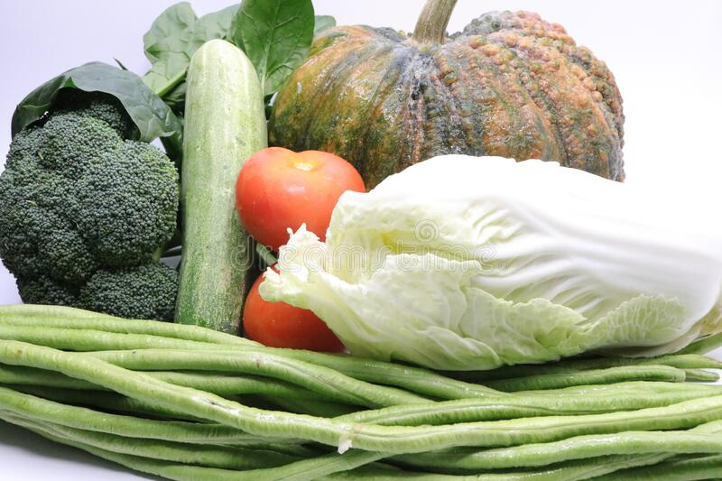 Pumpkin, tomatoes, long beans, Chinese cabbage, broccoli, cucumber royalty free stock photo