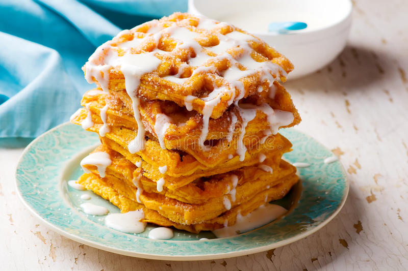 Pumpkin waffles with cream cheese glaze royalty free stock images