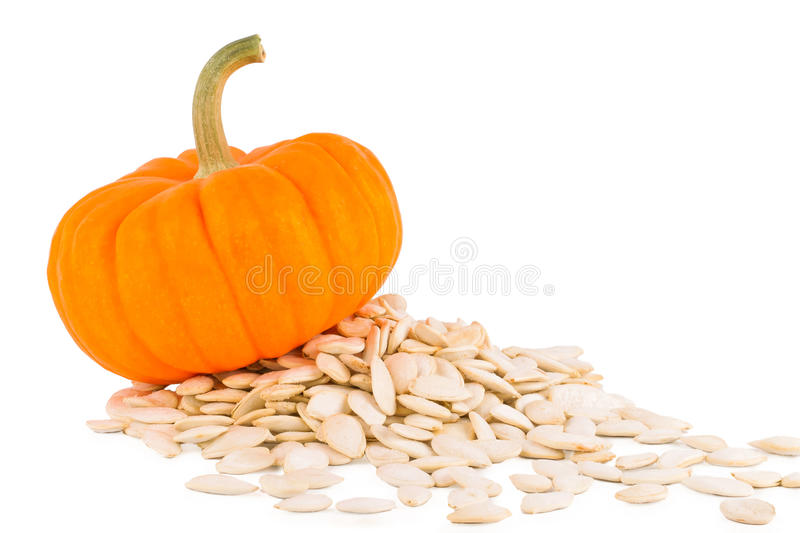 Pumpkin on a white background with seeds royalty free stock images