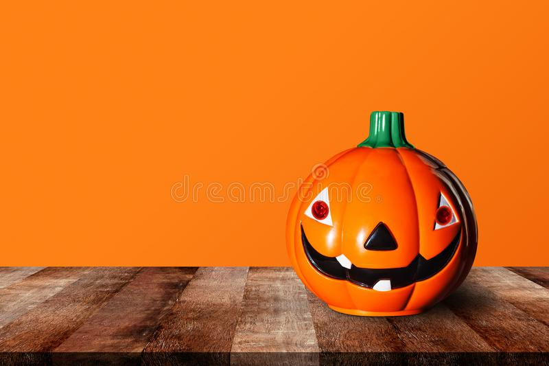 Pumpkin on wooden table with orange background. wood old shelf. shelves. Halloween and decoration concept. Pumpkin on wooden table with orange background. wood stock images