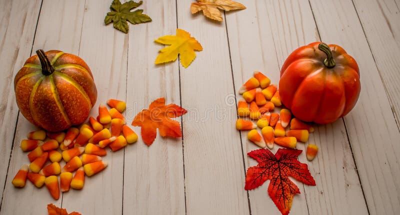 Pumpkins and Candy Corn Seasonal Home Decor stock photos