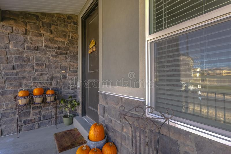 Pumpkins decorate a brick entry way of home stock photography