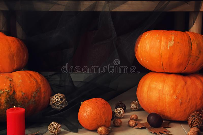 Pumpkins with decorations for Halloween party on floor royalty free stock photo