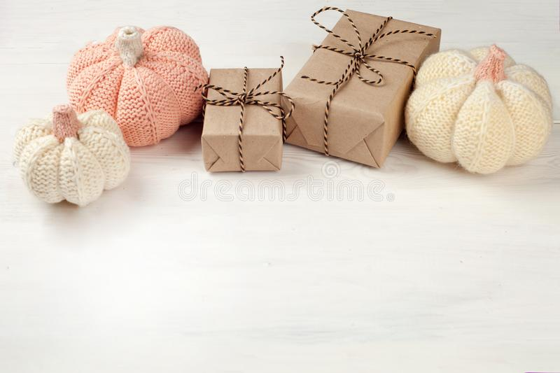 Pumpkins with gifts o on white wooden background for Halloween Holiday, rustic, copy space. royalty free stock images