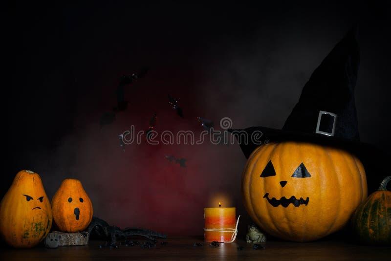 A pumpkin in a black hat. Halloween background. stock photos