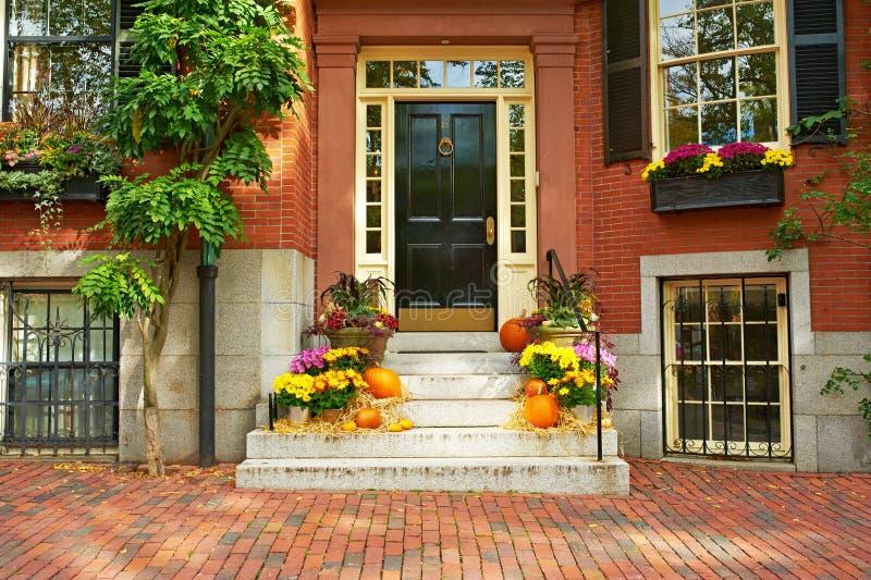 Pumpkins near the door for Halloween stock photography