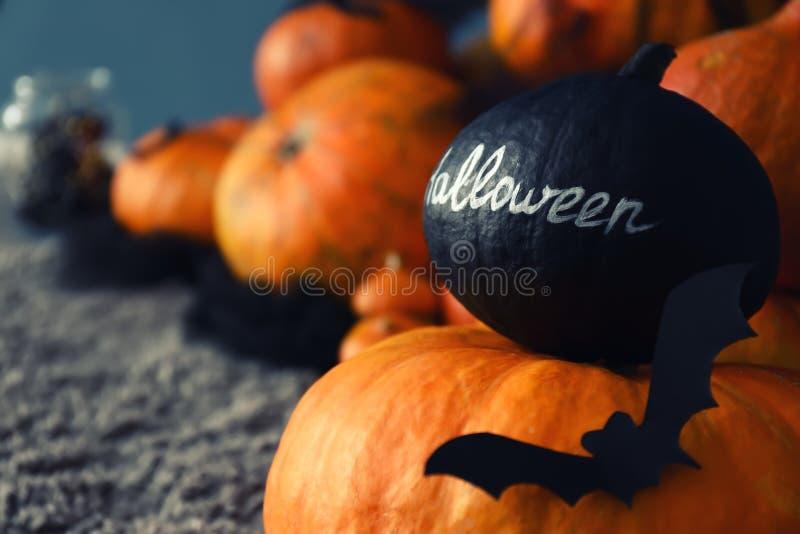 Pumpkins prepared for Halloween party on floor stock image