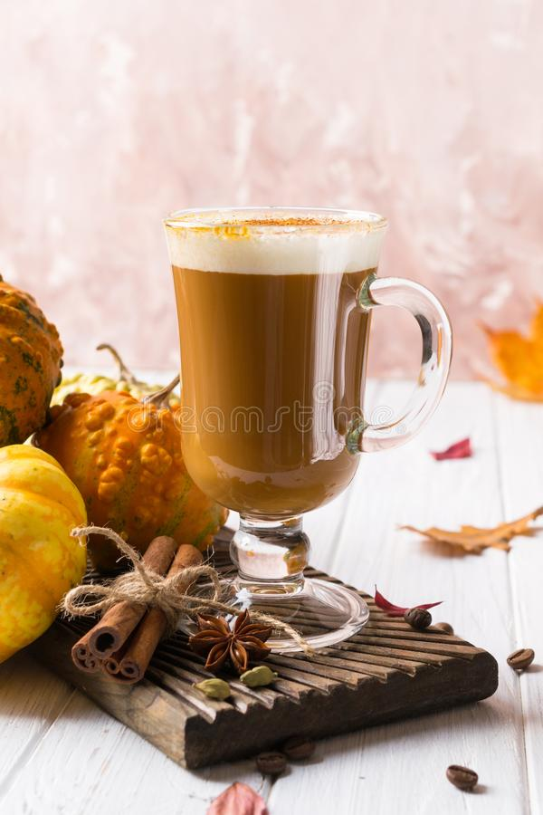 Pumpkins spice latte with pumpkins Copy space. Pumpkin latte - cozy drink for  cold fall or winter royalty free stock image