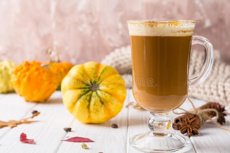 Pumpkins spice latte with pumpkins Copy space. Pumpkin latte -   cozy drink for cold fall or winter stock image
