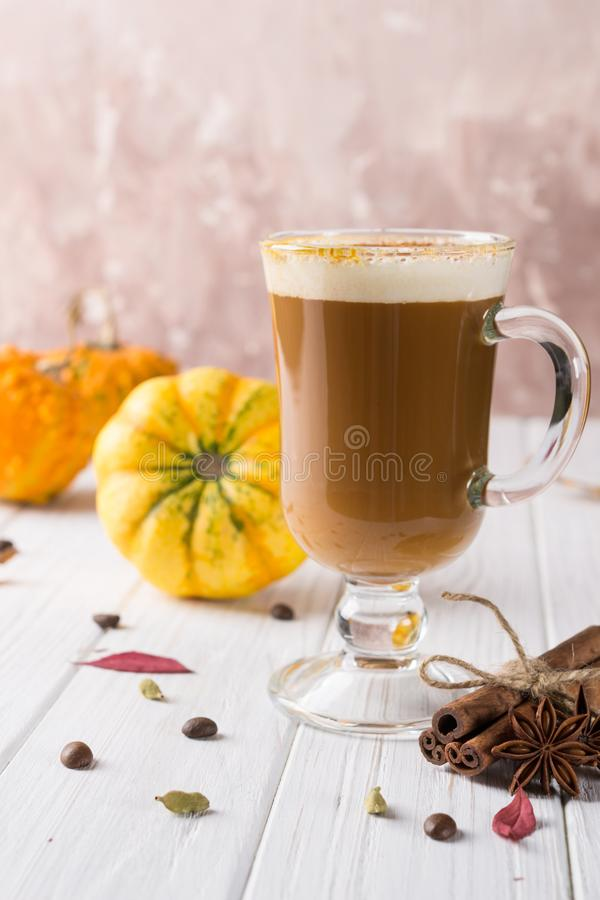 Pumpkins spice latte with pumpkins Copy space. Pumpkin latte - cozy drink for  cold fall or winter royalty free stock photography