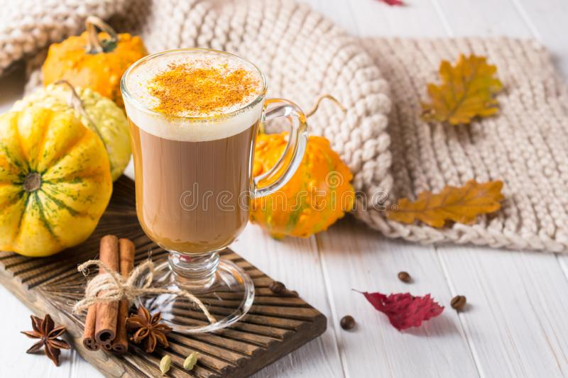Pumpkins spice latte with pumpkins Copy space. Pumpkin latte - cozy drink for fall or winter royalty free stock images