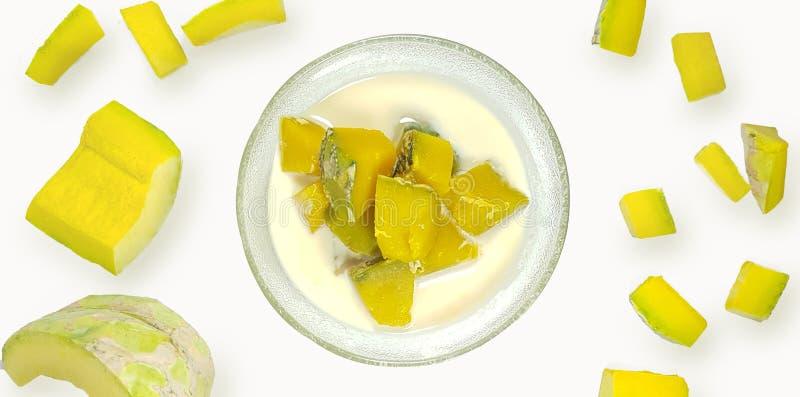 Pumpkins in sweet coconut milk with fresh Pumpkin Slides on white blackground,Thai dessert royalty free stock photography