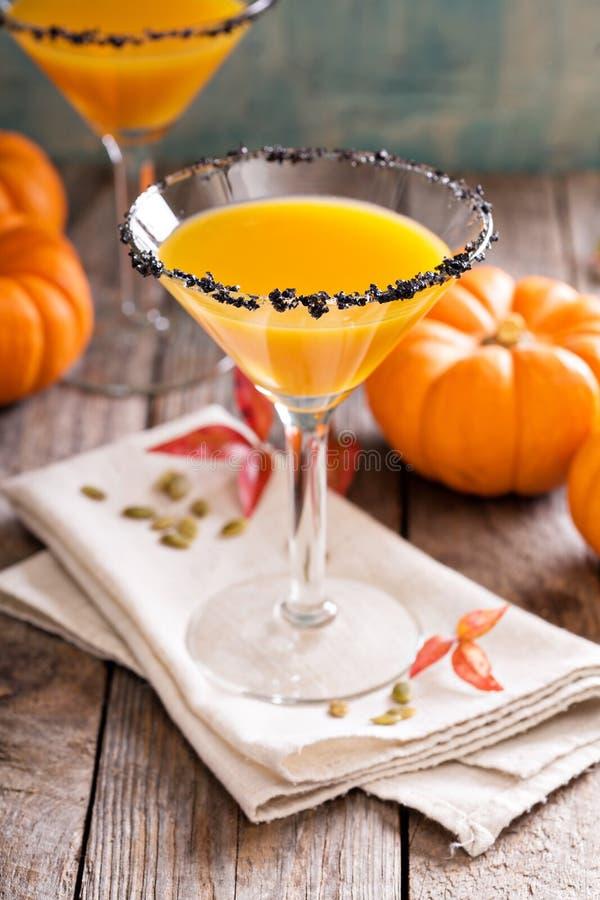 Pumpkintini pumpamartini coctail arkivfoto