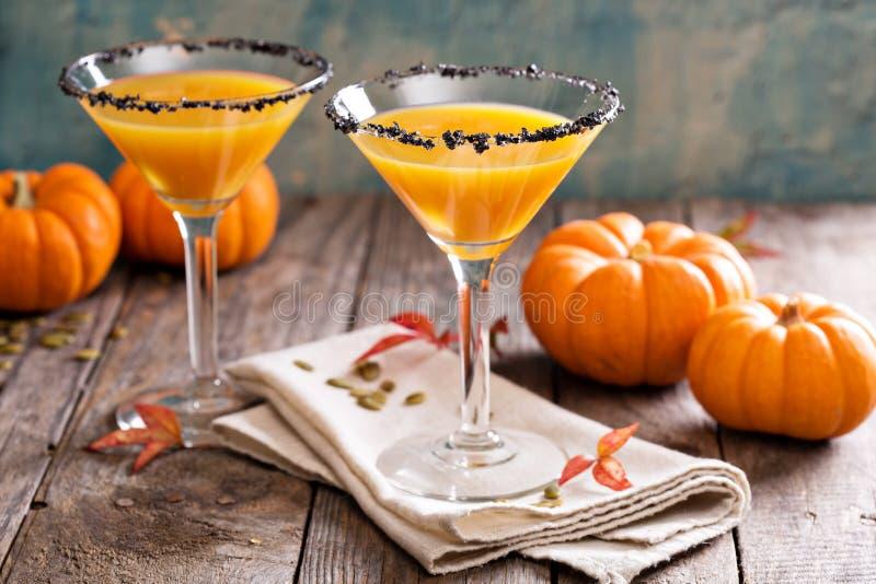 Pumpkintinipompoen martini coctail stock foto's