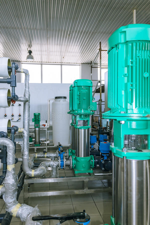 Pumps and piping system stock images