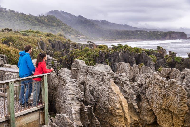 Punakaiki Pancake Rocks tourists couple travel in Paparoa National Park, West Coast, South Island, New Zealand royalty free stock images