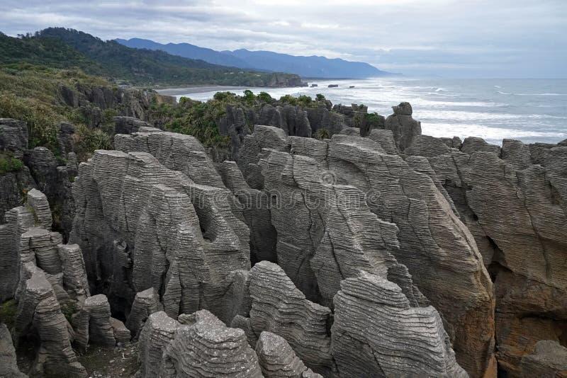 Punakaiki rocks and Tasman Sea on West Coast of New Zealand. Pancake rocks in Tasman Sea on Wast Coast at Punakaiki on the South Island of New Zealand on a royalty free stock photos