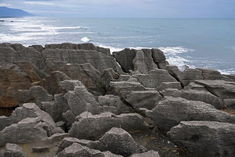 Punakaiki rocks and Tasman Sea on West Coast of New Zealand. Pancake rocks in Tasman Sea on Wast Coast at Punakaiki on the South Island of New Zealand on a royalty free stock image